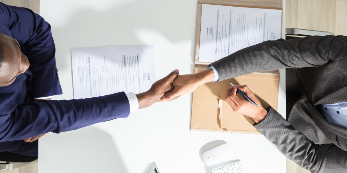 Professional men shaking hands in a business setting
